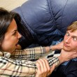 Office fight: Woman trying to stifle a man on the sofa — Stok fotoğraf