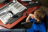 Dj working in front of a microphone on the radio, from the top — Stock Photo