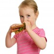 Young little girl eating sandwich isolated on white — Stock Photo #11133035