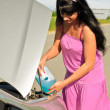 Woman pours a liquid for washing glasses to the car — Stock Photo #11327515