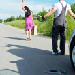 Stock Photo: Wonam is leaving mechanic alone near broken car.