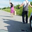 Wonam is leaving mechanic alone near the broken car. - Stock Photo