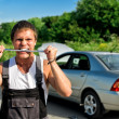 Mad mechanic near broken car on road. — Stock Photo #11327568
