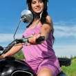 Portrait of a pretty woman riding a motorcycle. — Stock Photo