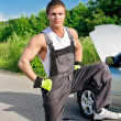 Portrait of a handsome mechanic on a road — Stock Photo