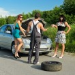 Mechanic and two girls near the broken car on a road — Stock Photo