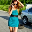 Stock Photo: Desperate girl calling to car repair service