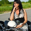 Portrait of a pretty woman on a retro motorcycle — Stock Photo #11327651