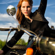 Redhead girl posing onretro motorbike — Stock Photo #11327684