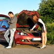 Royalty-Free Stock Photo: Man and woman near the broken car.
