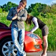 Man is waiting his girlfriend repairs a broken car — Foto de Stock