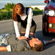 Stock Photo: Young man reanimation on a road. Concept first aid