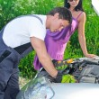 Mechanic measures lead acid battery charge. — Stock Photo #11329976