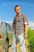 Attractive male changing tires on the road — Stock Photo