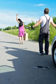 Wonam is leaving mechanic alone near the broken car. — Stock Photo
