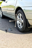 Tire change on a road close up. — Stock Photo