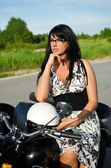 Portrait of a pretty woman on a retro motorcycle — Stock Photo