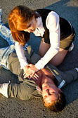 Young man reanimation on a road. Concept first aid — Stock Photo