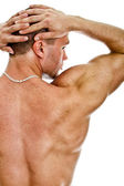Half of the muscular bodybuilder back. Isolated on white. — Stock Photo