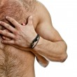 Male and female hand on the man's chest. Isolated on white. — Stock Photo