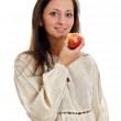 Female in rural clothes eating apple. Isolated on white. — Stock Photo