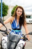 Young female sitting on a sports bike — Stock Photo