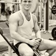 Portrait of smiling bodybuilder in fitness club — Stok Fotoğraf #11827345