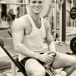 图库照片: Portrait of smiling bodybuilder in fitness club