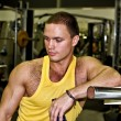 Portrait of handsome bodybuilder in fitness club — Stock Photo