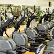 Stock Photo: Athletic xtrainer machines in fitness club
