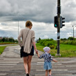 Mother and little daughter on zebra crossing — Stock Photo