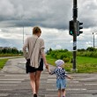 Mother and little daughter on zebra crossing — Stock Photo #11827503