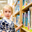 Little girl is shopping at the children's store. — Stock Photo #11827526