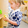 Little girl is shopping at the children's store. — Stock Photo #11827528