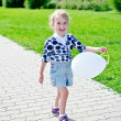 Smiling little girl with balloon in park. — Stock Photo #11827533