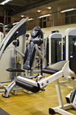 Athletic gym machine in fitness club — Стоковое фото