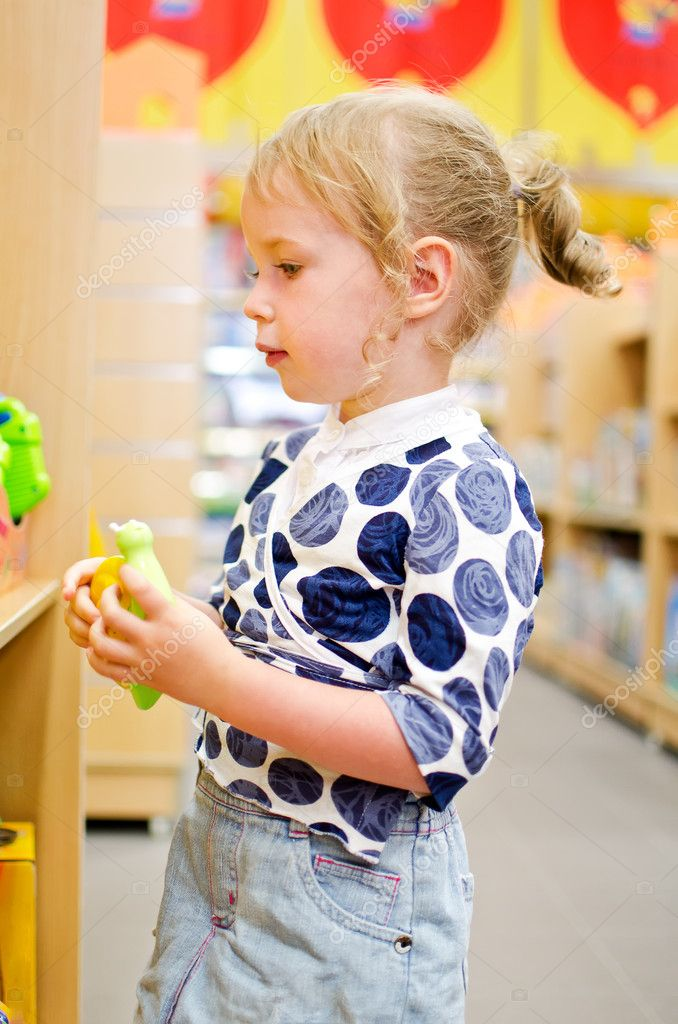 Little girl is shopping at the children&#039;s store.  Stock Photo #11827528