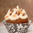 Stock Photo: Delicious carrot cake cupcake with cream cheese frosting and nut