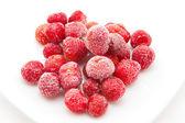 Sweet, luscious frozen strawberries on white — Stock Photo