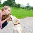 Woman playing  with puppy outdoor - Stock Photo