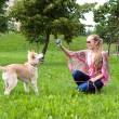 Girl playing in the park with puppy - Stock Photo