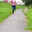 Girl runs with her puppy - Stock Photo