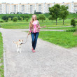 Girl walk with her puppy - Stock Photo