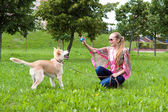 Girl playing in the park with puppy — Stock Photo