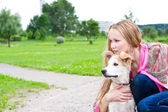 Beautiful girl hugging his dog — Stock Photo