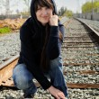 Stock Photo: Girl sitting in railway