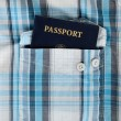 Passport in plaid shirt — Stock Photo
