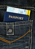 Pasport with boarding pass in jeans — Stock Photo