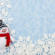 Snowflakes with snowman making a border on a blue background — Stock Photo