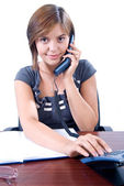 Young woman answers the phone — Stock Photo
